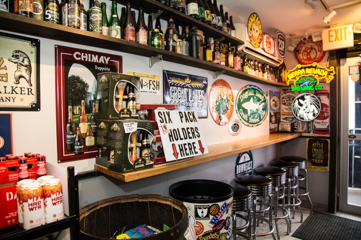Interior bar seating with beer-themed memorabilia
